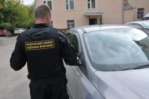Как арестовывают авто судебные приставы у предприятия